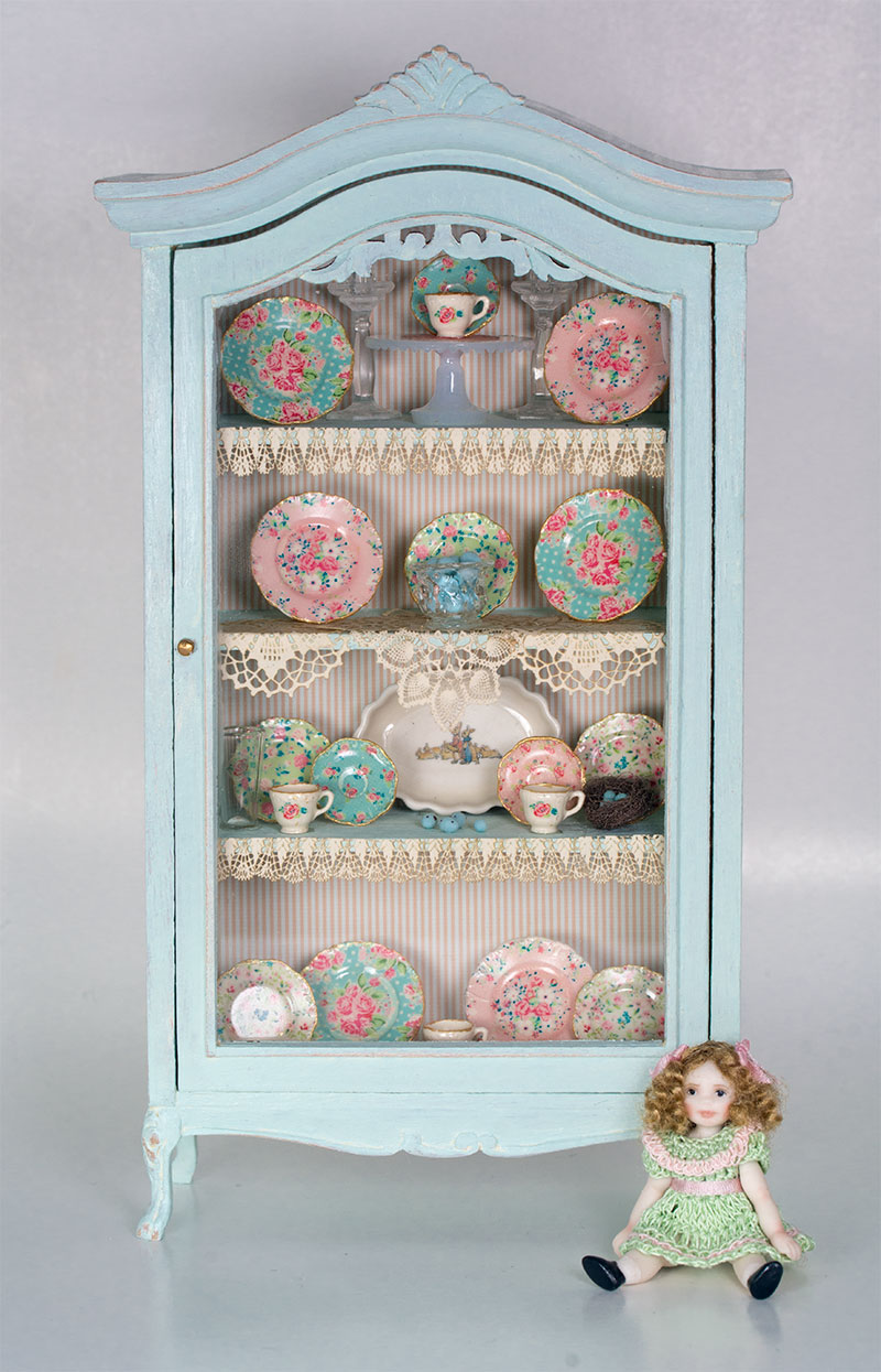 chalk painted collector's cabinet